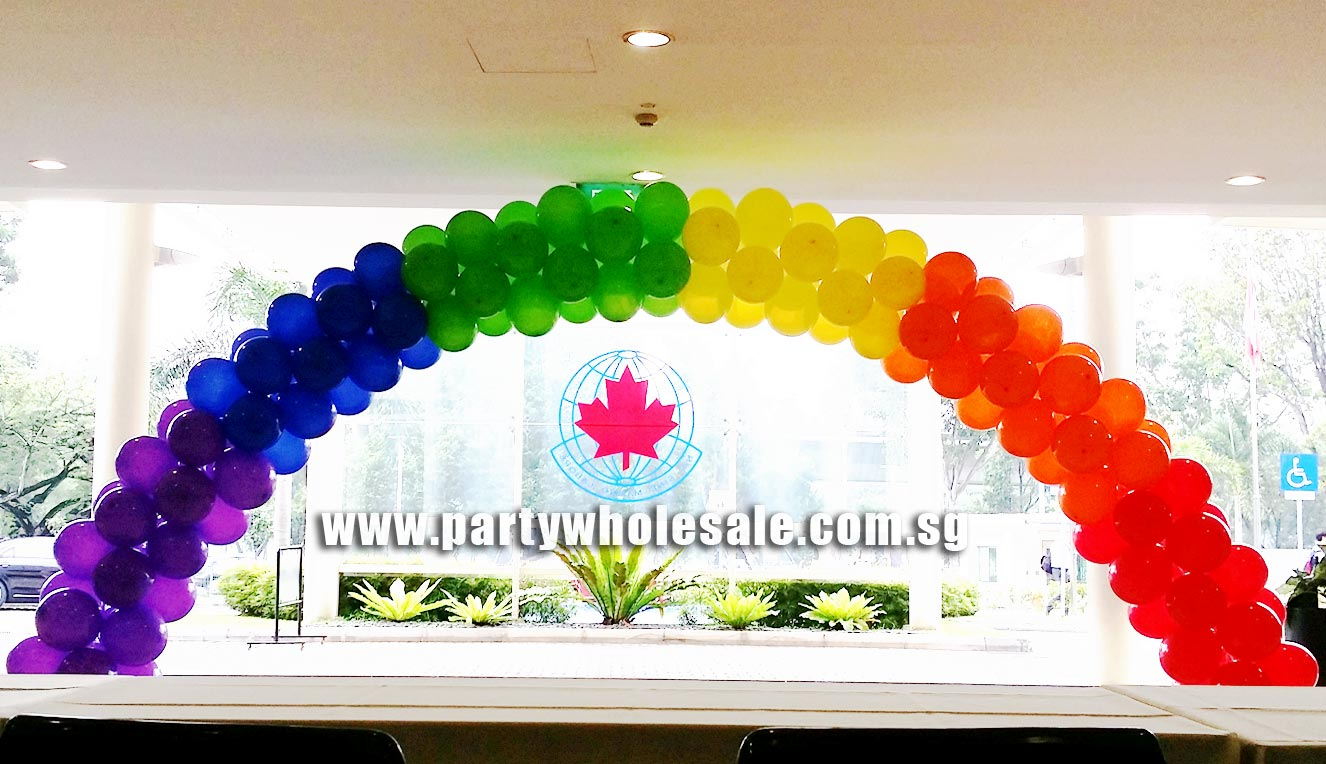 Colour rainbow balloon arch at canadian international for How to make a rainbow arch