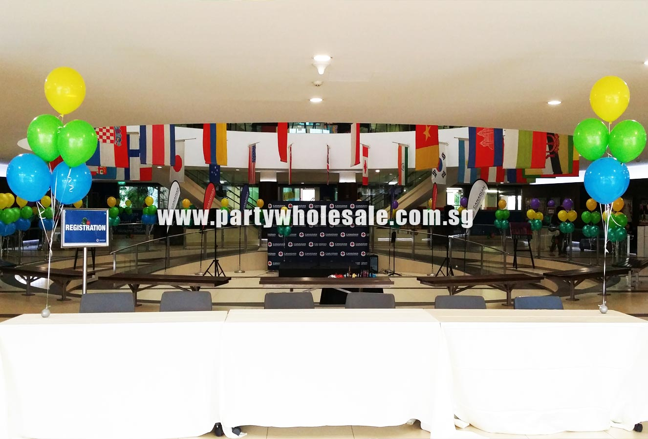 Colour rainbow balloon arch at canadian international for Decor international wholesale